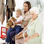 grandmother sitting with her granddaughter and daughter in a waiting room Stock Photo - Premium Royalty-Freenull, Code: 618-00488619