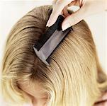 Close-up of young woman's hair being combed Stock Photo - Premium Royalty-Freenull, Code: 618-00488871