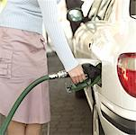 woman filling her car with petrol Stock Photo - Premium Royalty-Free, Artist: Kathleen Finlay, Code: 618-00493957