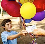 boy (6-8) buying balloons Stock Photo - Premium Royalty-Free, Artist: Guntmar Fritz, Code: 618-00494533