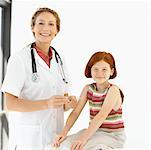 Portrait of a female medical professional with a girl (8-10) Stock Photo - Premium Royalty-Freenull, Code: 618-00499197