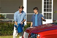 Father and teenage son (18-20) washing a car together Stock Photo - Premium Royalty-Freenull, Code: 618-00499929