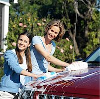 Portrait of a mother and teenage daughter (17-18) washing the car Stock Photo - Premium Royalty-Freenull, Code: 618-00499947