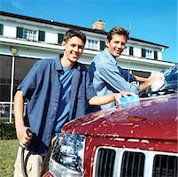 Portrait of a father and teenage son (18-20) washing the car Stock Photo - Premium Royalty-Freenull, Code: 618-00499949
