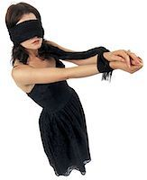 Young woman standing blindfolded with her hands tied Stock Photo - Premium Royalty-Freenull, Code: 618-00501288