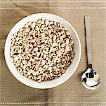 Elevated view of a bowl of puffed cereal with a spoon Stock Photo - Premium Royalty-Freenull, Code: 618-00506708