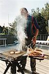 Man Barbecuing in Backyard    Stock Photo - Premium Rights-Managed, Artist: Anders Hald, Code: 700-00506827
