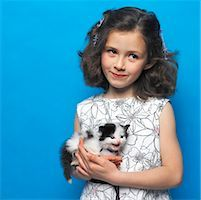 preteen girl pussy - girl (7-9) holding a kitten Stock Photo - Premium Royalty-Freenull, Code: 618-00510357