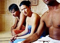 sweaty woman - Side profile of a young woman sitting between two young men in a sauna Stock Photo - Premium Royalty-Freenull, Code: 618-00511105