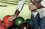 Bowler Reaching for Bowling Ball    Stock Photo - Premium Rights-Managed, Artist: TSUYOI, Code: 700-00513715