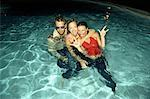 Friends Goofing Around in Pool    Stock Photo - Premium Rights-Managed, Artist: TSUYOI, Code: 700-00513720