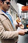 Man Buying Pretzel, New York, New York, USA