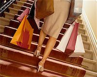 Woman Climbing Stairs, Carrying Shopping Bags    Stock Photo - Premium Rights-Managednull, Code: 700-00514856