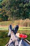 Businessman Relaxing in Canoe