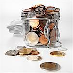 Jar Overflowing with Coins    Stock Photo - Premium Rights-Managed, Artist: Edward Pond, Code: 700-00515189
