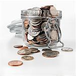 Jar Overflowing with Coins    Stock Photo - Premium Rights-Managed, Artist: Edward Pond, Code: 700-00515192