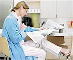 Woman Reading the News Paper    Stock Photo - Premium Rights-Managed, Artist: Philip Rostron, Code: 700-00518491