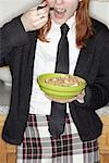 School Girl Eating Cereal