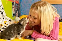 preteen girl - Girl Playing with Kitten    Stock Photo - Premium Rights-Managednull, Code: 700-00519389