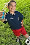 Boy with Soccer Ball and Trophy    Stock Photo - Premium Rights-Managed, Artist: Roy Ooms, Code: 700-00521016