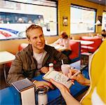 Man Flirting With Waitress In Diner    Stock Photo - Premium Rights-Managed, Artist: Horst Herget, Code: 700-00521549