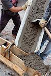 Men Pouring Cement at Construction Site