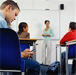 Student Text Messaging In The Classroom    Stock Photo - Premium Rights-Managed, Artist: Masterfile, Code: 700-00523370