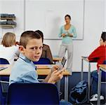 Student Playing Video Games In The Classroom    Stock Photo - Premium Rights-Managed, Artist: Masterfile, Code: 700-00523371