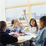 Girl Raising Hand in Classroom