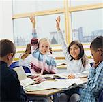 Girls Raising Hands in Classroom