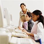 Teacher and Students in Classroom    Stock Photo - Premium Rights-Managed, Artist: Masterfile, Code: 700-00523436