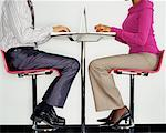 Two Business People using Laptops    Stock Photo - Premium Rights-Managed, Artist: Masterfile, Code: 700-00523777