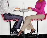 Woman Touching Man with her Foot at Work    Stock Photo - Premium Rights-Managed, Artist: Masterfile, Code: 700-00523778