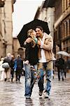 Couple Walking With Umbrella, Florence, Italy    Stock Photo - Premium Rights-Managed, Artist: Mark Leibowitz, Code: 700-00524063