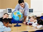 Teacher and Children in Classroom    Stock Photo - Premium Rights-Managed, Artist: Masterfile, Code: 700-00524553