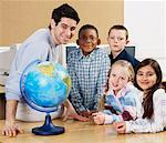 Teacher and Children in Classroom    Stock Photo - Premium Rights-Managed, Artist: Masterfile, Code: 700-00524554