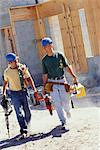 Two Men Leaving Construction Site    Stock Photo - Premium Rights-Managed, Artist: Kevin Dodge, Code: 700-00524893