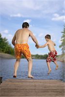 Father and Son Jumping into Lake    Stock Photo - Premium Rights-Managednull, Code: 700-00525039