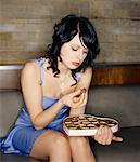 Woman Eating Box of Chocolates    Stock Photo - Premium Rights-Managed, Artist: Masterfile, Code: 700-00526544