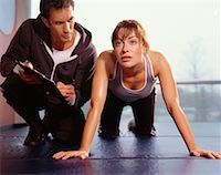 Woman Exercising, With Personal Trainer    Stock Photo - Premium Rights-Managednull, Code: 700-00526639