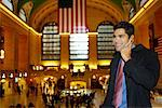 Man Using Cellular Phone in Grand Central Station, New York, USA    Stock Photo - Premium Rights-Managed, Artist: Mark Leibowitz, Code: 700-00527037