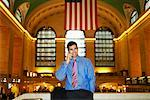 Man Using Cellular Phone in Grand Central Station, New York, USA    Stock Photo - Premium Rights-Managed, Artist: Mark Leibowitz, Code: 700-00527039