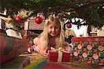 Girl Opening Christmas Presents    Stock Photo - Premium Rights-Managed, Artist: Gary Rhijnsburger, Code: 700-00527493