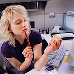 Businesswoman Sitting at Desk Filing her Fingernails    Stock Photo - Premium Rights-Managed, Artist: Masterfile, Code: 700-00528787