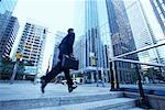 Businessman Rushing to Work    Stock Photo - Premium Rights-Managed, Artist: Peter Griffith, Code: 700-00529295