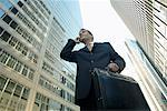 Businessman Using Cell Phone    Stock Photo - Premium Rights-Managed, Artist: Peter Griffith, Code: 700-00529310