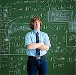 Portrait of Man in Front of Chalkboard with Arms Crossed    Stock Photo - Premium Rights-Managed, Artist: Edward Pond, Code: 700-00529399