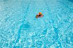 Girl Playing In Swimming Pool, Bangkok, Thailand    Stock Photo - Premium Rights-Managed, Artist: dk & dennie cody, Code: 700-00530258