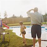 Grandfather and Granddaughter by Pool    Stock Photo - Premium Rights-Managed, Artist: Tom Feiler, Code: 700-00530694