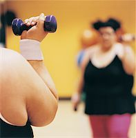 Close Up Detail of a Woman Doing Weight Training in a Gym Stock Photo - Premium Royalty-Freenull, Code: 613-00533996